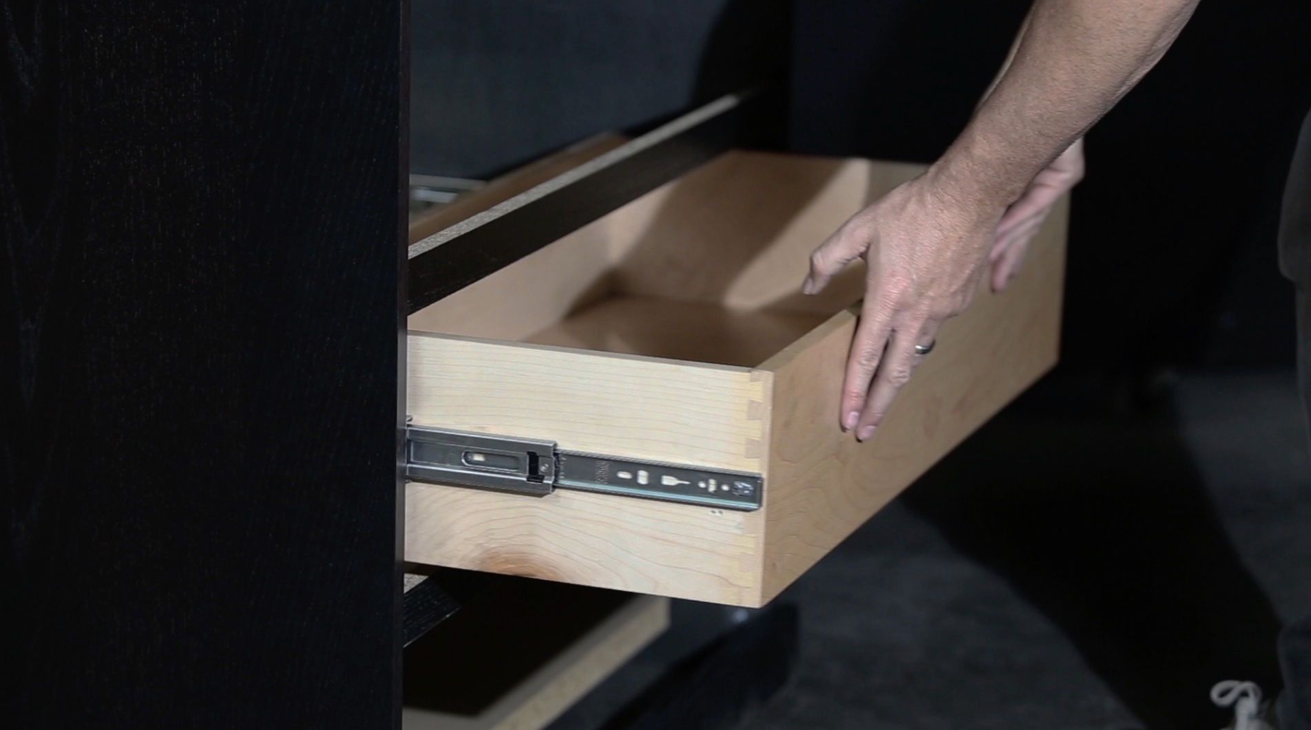 Once your retainers are fully extended outward, insert your drawer. You'll feel resistance when pushing the drawer fully closed—push firmly to reconnect the members.